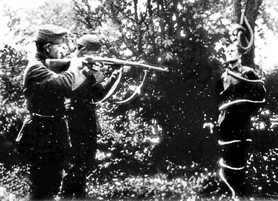 14 Розстріл гонведами полоненого січовика, прив'язаного в лісі до дерева. Друга половина березня 1939 р.